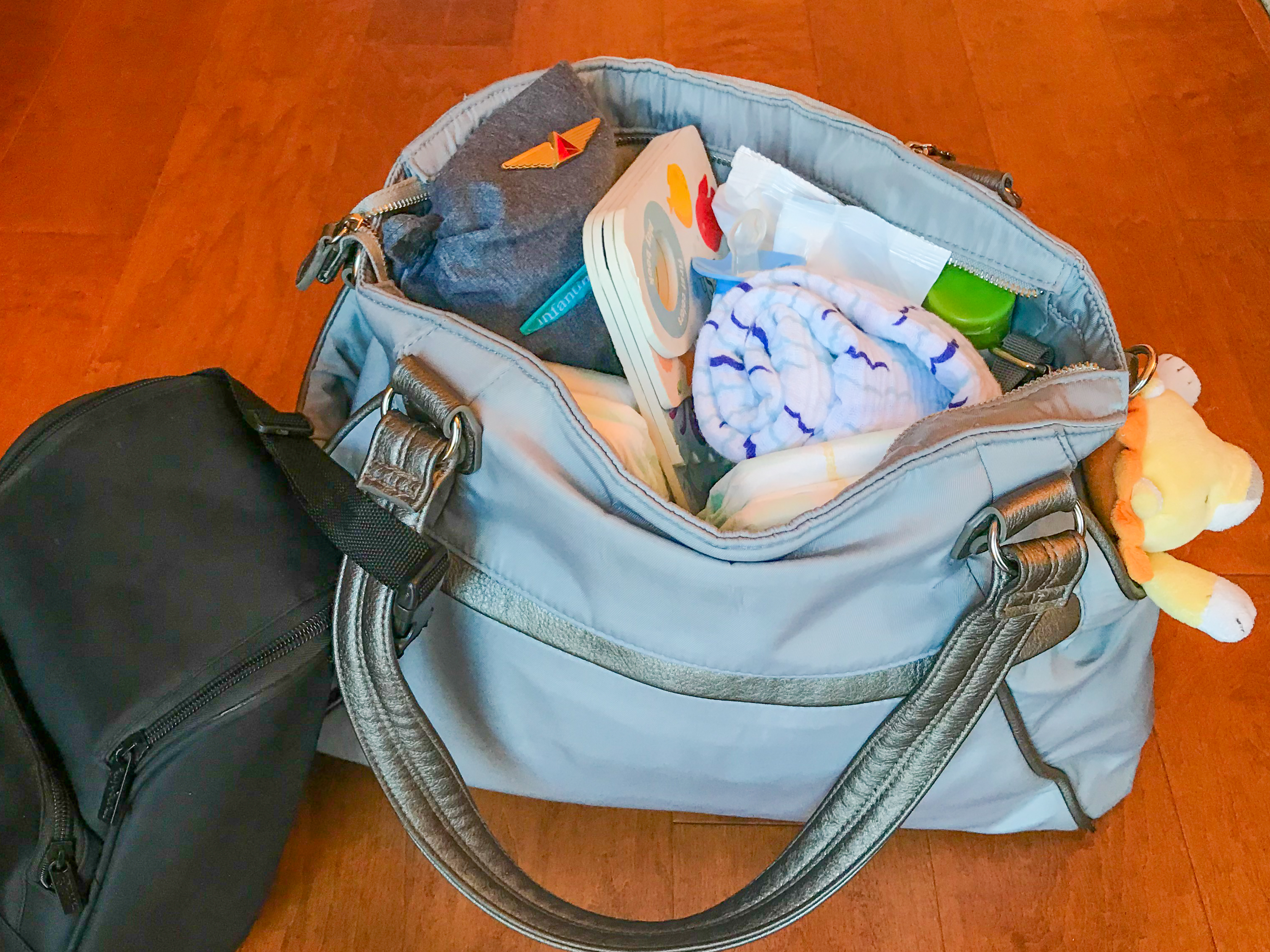 Travel Gear and Tips to Survive Baby's First Flight (Even